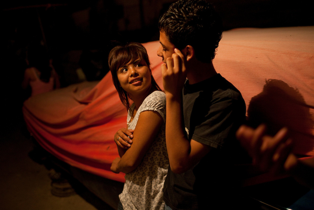 A young couple hangs out in Ciudad Juarez, Chihuahua Mexico on May 7, 2010. ..