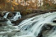 Triple water falls run over the rocks into the Towaliga River Below.