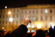 Havel was a Czech playwright, essayist, poet, dissident and politician. After the announcement of his death spontaneously thousands of people People are meeting on Wenceslas Square and other places in Prague to commemorate the death of former Czech President Vaclav Havel with flowers and candles. A man honoring Havel with the victory sign.