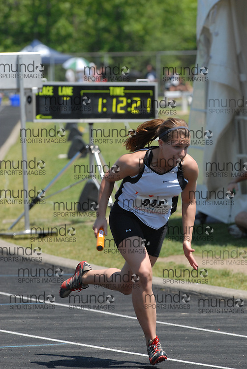 Hamilton, Ontario ---06/06/08--- Karley Albrecht of LaSalle in Sudbury competes in the 4X100 meter relay at the 2008 OFSAA Track and Field meet in Hamilton, Ontario..Mark Butterwick