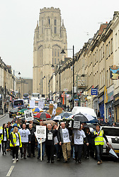 &copy; Licensed to London News Pictures. 02/04/2014; Bristol, UK.  Residents and traders from Clifton Village in Bristol held a street march from Clifton to Bristol City Hall to protest about plans for a Residents Parking Zone in their area.  They say the business and social life of the area will be hit very hard by the RPZ with customers and visitors unable to park, and that some businesses will have to close or move away from the area.  Bristol's elected Mayor, George Ferguson, came out to meet the protesters which were led by Tony Miles aka  Smiley Miley from the Radio 1 Roadshow.<br /> Photo credit: Simon Chapman/LNP