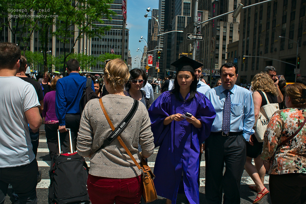 Young woman in cap and gown after NYU Steinhardt school graduation at Radio City, May 20, 2013, New York, NY