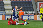 Coventry midfielder Jacob Murphy tackles Wigan Midfielder David Perkins during the Sky Bet League 1 match between Wigan Athletic and Coventry City at the DW Stadium, Wigan, England on 9 April 2016. Photo by John Marfleet.