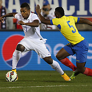 Joseph-Claude Gyau, (left), USA, dribbles past Alex Ibarra, Ecuador, during the USA Vs Ecuador International match at Rentschler Field, Hartford, Connecticut. USA. 10th October 2014. Photo Tim Clayton