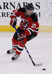Oct 5, 2009; Newark, NJ, USA; New Jersey Devils center Rob Niedermayer (21) skates with the puck during the third period at the Prudential Center. The Rangers defeated the Devils 3-2.