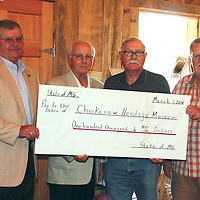 (Floyd Ingram / Buy at photos.chickasawjournal.com)<br /> The Chickasaw County Heritage Museum received a check for $100,000 Saturday from the Legislature. Shown are Chickasaw County Senator Russell Jolly, from left, Representative Preston Sullivan, Musem Vice President Gary Huffman and Museum President Lamar Beaty.