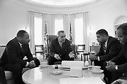 Lyndon Baines Johnson (1908-1973) 36th President of the United States in talks with Civil Rights leaders in the White House, including  Martin Luther King, Jr (1929-1968), left.
