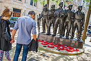 People sop to spare a thought for the men of the Royal Tank Regiment at their memorial. VE Day 70 commemorations -  marking historic anniversary of end of the Second World War in Europe. following a Service of Thanksgiving at Westminster Abbey, a parade of Service personnel and veterans and a flypast - down whitehall and into Horse Guards Parade.