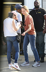 EXCLUSIVE: A bare-faced and frumpily dressed Jennifer Lawrence vapes and drinks from a Coca-Cola can while her personal assistant uses an electrical fan to cool her on the set of her new film, 'Untitled Soldier Project'. During breaks from filming the 'Hunger Games' actress was seen sipping an iced beverage from PJ's Coffee and eating tuna salad on crackers. Lawrence was wearing a rust colored v-neck t-shirt, blue jeans, Saucony tennis shoes and her hair pulled back into a ponytail. 16 Jul 2019 Pictured: Jennifer Lawrence. Photo credit: MEGA TheMegaAgency.com +1 888 505 6342