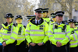 © Licensed to London News Pictures. 15/04/2019. London, UK. Large police presence as environmental activists demonstrates in Parliament Square to demand decisive action from the UK Government. The protest is organised by Extinction Rebellion. Photo credit: Dinendra Haria/LNP