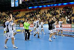 Players of Kiel celebrate after the handball match between RK Celje Pivovarna Lasko (SLO) and TWH Kiel (GER) in 4th Round of Velux EHF Men's Champions League, on October 17, 2010 in Arena Zlatorog, Celje, Slovenia.  Kiel defeated Celje 34 - 28. (Photo By Vid Ponikvar / Sportida.com)