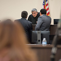 Judge James Sanchez, center, brings both legal teams to the bench to ensure both sides know they may not to state the victims name during the case on Day 1 of the Green Case at the 13th Judicial District Courthouse in Grants Tuesday afternoon.