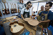 "Young instrument makers supervised by master Luis Alaluna at Acade?mico de Lutheri?a, the main instrument making and repair facility of the ""Fundacion del Estado para el Sistema Nacional de las Orquestas Juveniles e Infantiles de Venezuela"" (FESNOJIV, National Network of Youth and Children Orchestras of Venezuela). This organisation is also known as El Sistema, a publicly financed private-sector music-education program in Venezuela, originally called Social Action for Music, founded 1975 by Venezuelan economist and amateur musician Jose? Antonio Abreu."