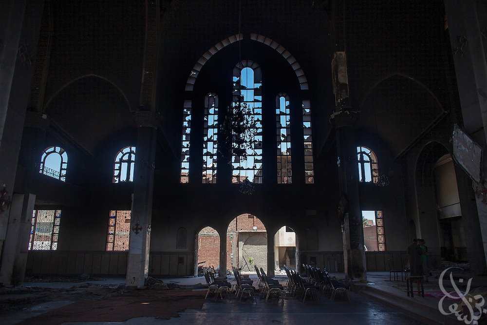 The burned and looted Virgin Mary Church is seen August 20, 2013 after a recent attack by Muslims in the village of Nazla, near el Fayoum, around a 100 kilometers South of Cairo, Egypt.  Christian villagers report 2 churches and a monastery in the area came under attack by their Muslim neighbors on the same day as Egyptian security forces were moving to forcibly disperse the sit-in camp of the supporters of deposed president Mohamed Morsi.