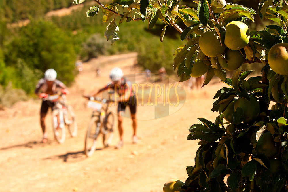 GORDON'S BAY, SOUTH AFRICA - hot push up in the vineyards during stage one of the Absa Cape Epic Mountain Bike Stage Race held between Gordon's Bay and Villiersdorp on the 22 March 2009 in the Western Cape, South Africa..Photo by Sven Martin   /SPORTZPICS