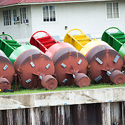 Buoys used to mark the shipping lanes on the Panama Canal. Opened in 1914, the Panama Canal is a crucial shipping lane between the Atlantic and Pacific Oceans that mean that ships don't have to go around the bottom of South America or over the top of Canada. The Canal was originally built and owned by the United States but was handed back to Panama in 1999.