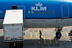 A KLM airplane is serviced before departure at Schiphol Airport in Amsterdam, the Netherlands, on Tuesday, April 20, 2010. (Photo © Jock Fistick)