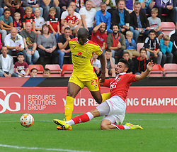 Bristol City's Derrick Williams challenges for the ball.  - Photo mandatory by-line: Nizaam Jones- Mobile: 07583 3878221 - 27/09/2014 - SPORT - Football - Bristol - Ashton Gate - Bristol City v MK Dons - Sports