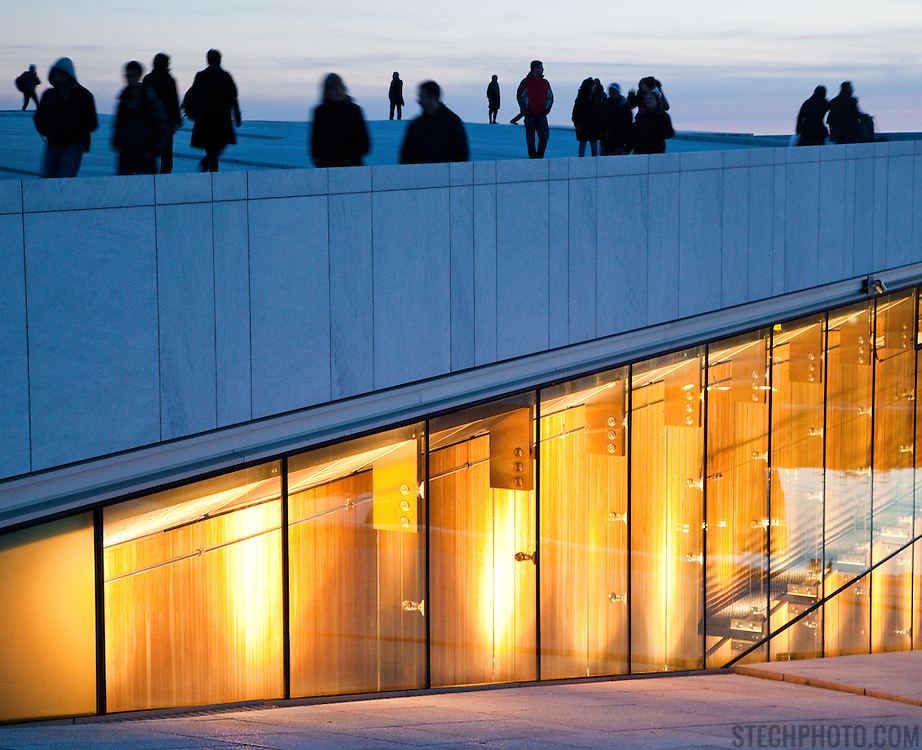 People walking on top of the Oslo Opera House (Operhuset) in Olso, Norway.