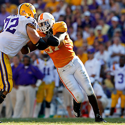 Oct 2, 2010; Baton Rouge, LA, USA; Tennessee Volunteers defensive end Malik Jackson (97) rushes against LSU Tigers offensive tackle Alex Hurst (72) during the second half at Tiger Stadium. LSU defeated Tennessee 16-14.  Mandatory Credit: Derick E. Hingle