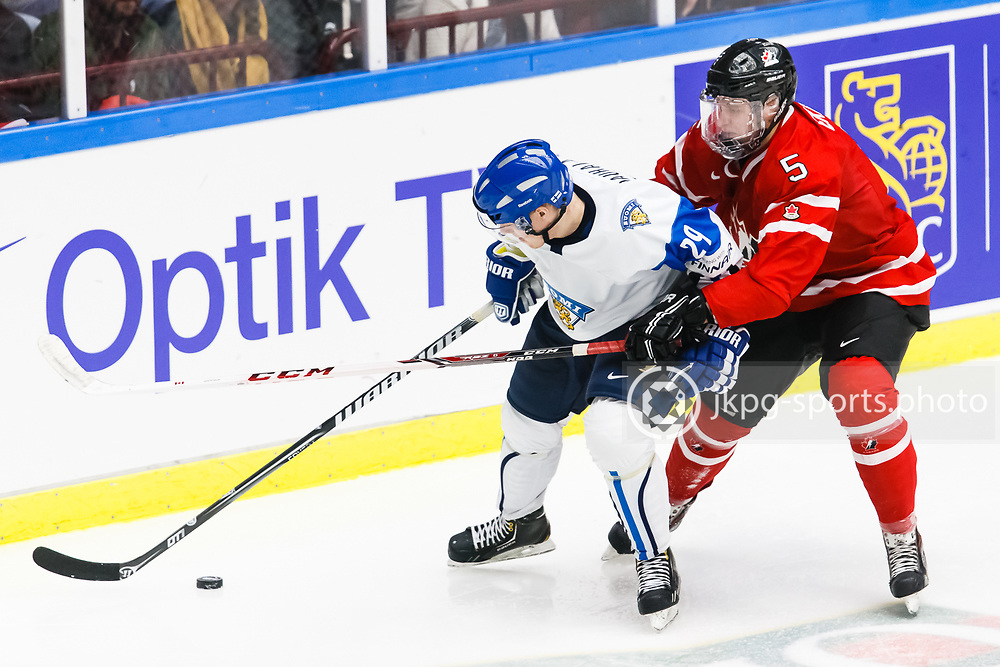 140104 Ishockey, JVM, Semifinal,  Kanada - Finland<br /> Icehockey, Junior World Cup, SF, Canada - Finland.<br /> Otto Rauhala, (FIN), Aaron Ekblad, (CAN).<br /> Endast f&ouml;r redaktionellt bruk.<br /> Editorial use only.<br /> &copy; Daniel Malmberg/Jkpg sports photo