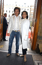ANDY & PATTI WONG at the opening party for Diamonds - a new exhibition at The Natural History Museum, London in association with De Beers held on 6th July 2005.<br /><br />NON EXCLUSIVE - WORLD RIGHTS