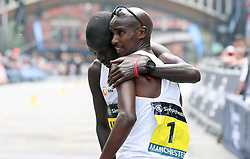Great Britain's Mo Farah (right) embraces second placed Uganda's Moses Kipsiro after winning the Simplyhealth Great Manchester Elite Men 10k run through Manchester.