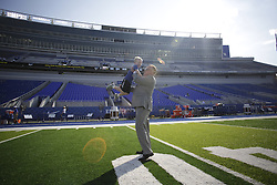 Kentucky head coach Mark Stoops grabs his son Zack on the field before the game. The University of Kentucky hosted Louisiana-Lafayette , Saturday, Sept. 05, 2015 at Commonwealth Stadium in Lexington. Photo by Jonathan Palmer