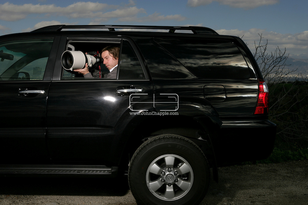29th January 2008, Los Angeles, California. Paparazzi photographer Alex Turner, who is a staff photographer with one of the largest celebrity news agencies, Splash News. Alex hides in his black 4x4 with black windows, using a huge telephoto lens on the look-out for celebrities. PHOTO © JOHN CHAPPLE / REBEL IMAGES.john@chapple.biz    www.chapple.biz