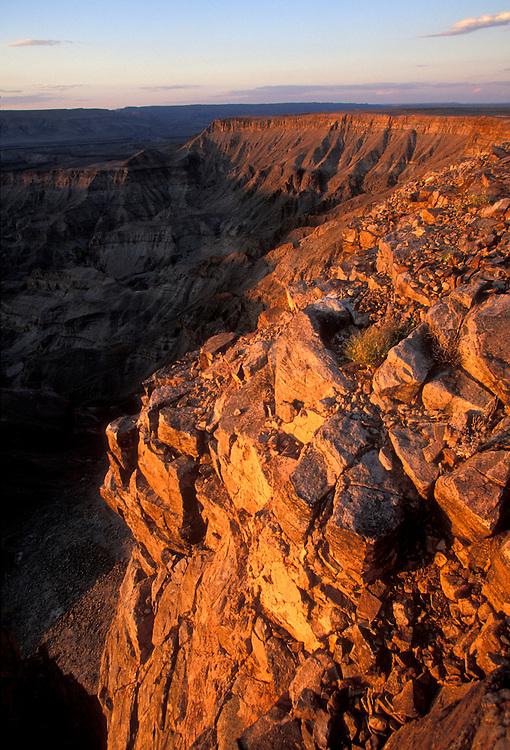 Namibia, Fish River Canyon Nat'l Park, Setting sun lights desert canyon walls