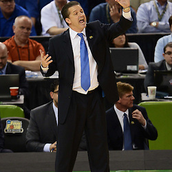 Apr 2, 2012; New Orleans, LA, USA; Kentucky Wildcats head coach John Calipari reacts against the Kansas Jayhawks during the first half in the finals of the 2012 NCAA men's basketball Final Four at the Mercedes-Benz Superdome. Mandatory Credit: Derick E. Hingle-US PRESSWIRE
