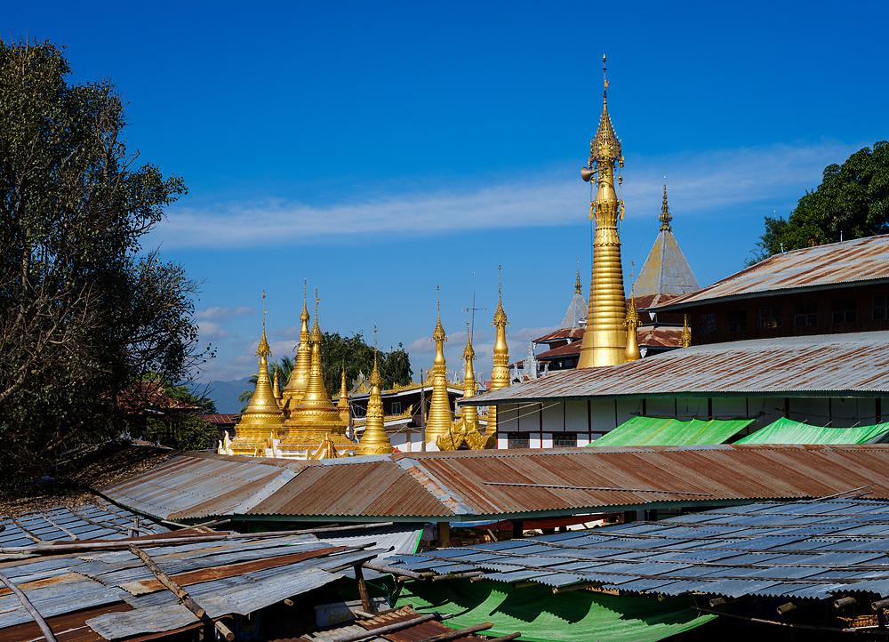 INLE LAKE, MYANMAR - CIRCA DECEMBER 2017: Rooftops of Inle Lake and Aung Mingalar Pagoda
