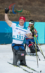 March 17, 2018 - Pyeongchang, South Korea - Dan Cnossen of the US celebrates his silver medal finish in the Cross Country 7.5km sitting event Saturday, March 17, 2018 at the Alpensia Biathlon Center at the Pyeongchang Winter Paralympic Games. Photo by Mark Reis (Credit Image: © Mark Reis via ZUMA Wire)