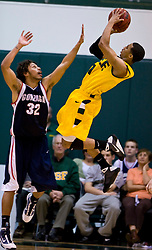 January 30, 2010; San Francisco, CA, USA;  San Francisco Dons guard Kwame Vaughn (1) shoots over Gonzaga Bulldogs guard Steven Gray (32) during the second half at the War Memorial Gym.  San Francisco defeated Gonzaga 81-77 in overtime.