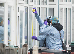 © Licensed to London News Pictures. 03/04/2018. London, UK. Members of a police forensics team examine and photograph the front door of a property at the scene on Chalgrove Road, Tottenham, north London where a 17 year old girl was shot dead. The girl was found with a bullet wound and pronounced dead at the scene at 21:43 last night. Photo credit: Ben Cawthra/LNP