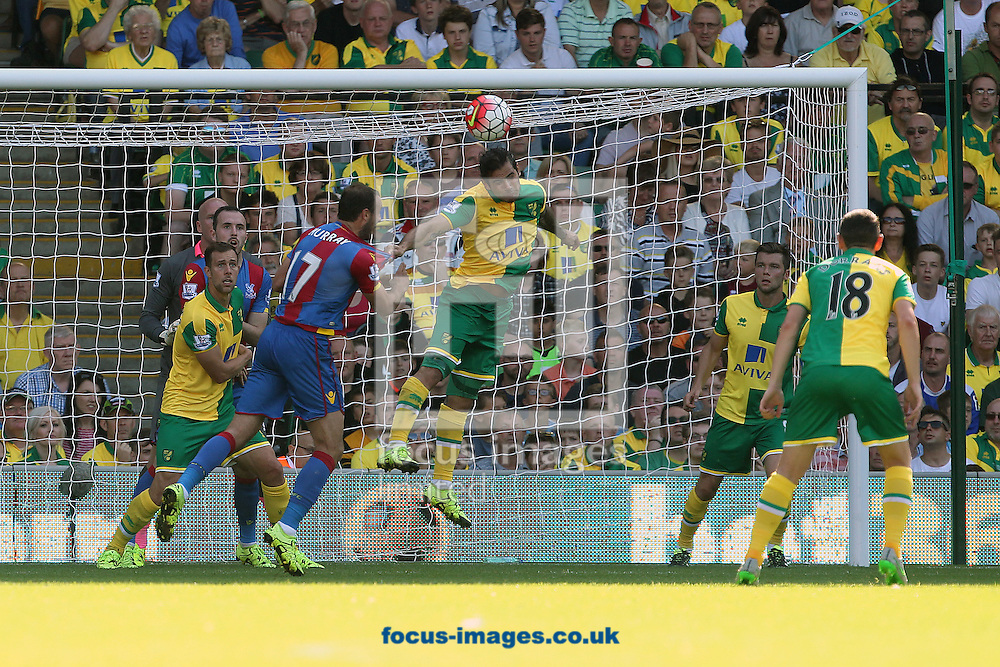 Bradley Johnson of Norwich heads clear during the Barclays Premier League match at Carrow Road, Norwich<br /> Picture by Paul Chesterton/Focus Images Ltd +44 7904 640267<br /> 08/08/2015