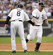 CHICAGO - JUNE 20:  Paul Konerko #14 celebrates with third base coach Jeff Cox #8 of the Chicago White Sox after Konerko hit a home run in the first inning against the Chicago Cubs on June 20, 2011 at U.S. Cellular Field in Chicago, Illinois.  The Cubs defeated the White Sox 6-3.  (Photo by Ron Vesely)  Subject:  Paul Konerko:Jeff Cox