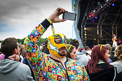 A festivalgoer wearing a Luchador mask at the Brownstock Festival in Essex.