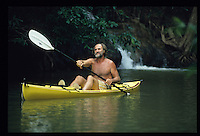 PHUKET, THAILAND: John Gray founder of Sea Canoe paddles around the sea caves off the coast of Phi Phi Island.Eco-Tourism in is taking off in areas like Phuket, Thailand.  Photograph by David Paul Morris