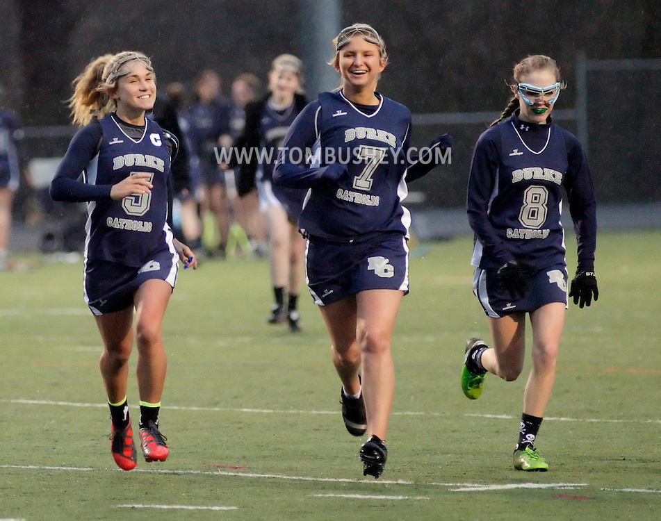 John S. Burke Catholic's Andrea Kuhl, (5), Oktavia Dabek (7) and Devin Lennon (8) run off the field at halftime of a game against Delaware Valley in Westfall Township, Pa., on Wednesday, April 6, 2011.