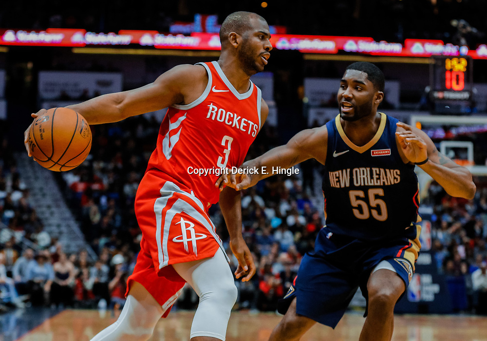 Jan 26, 2018; New Orleans, LA, USA; Houston Rockets guard Chris Paul (3) is defended by New Orleans Pelicans guard E'Twaun Moore (55) during the second quarter at the Smoothie King Center. Mandatory Credit: Derick E. Hingle-USA TODAY Sports