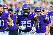 Minnesota Vikings Runningback Latavius Murray (25) runs off the field at the end of warm ups during the International Series match between Cleveland Browns and Minnesota Vikings at Twickenham, Richmond, United Kingdom on 29 October 2017. Photo by Jason Brown.
