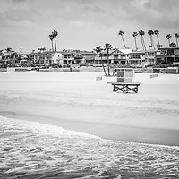Seal Beach California black and white picture with the Pacific Ocean, lifeguard tower, and oceanfront homes. Seal Beach is in Orange County Southern California in the United States of America.