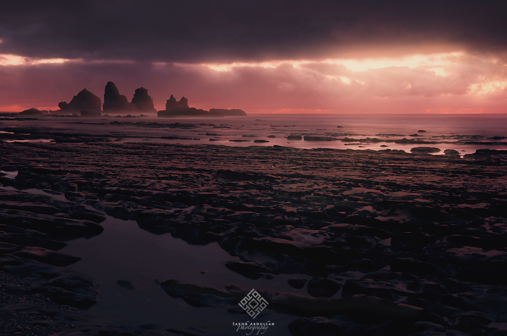After I finished photographing several large rocks in the west coast of New Zealand and I had packaged all my gears to leave, where the clouds had closed the sky.<br />