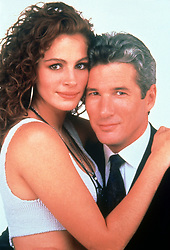 RELEASE DATE: March 23, 1990 <br /> MOVIE TITLE: Pretty Woman <br /> STUDIO: Touchstone Pictures <br /> DIRECTOR: Garry Marshall <br /> PLOT: A man in a legal but hurtful business needs an escort for some social events, and hires a beautiful prostitute he meets... only to fall in love. <br /> PICTURED: RICHARD GERE as Edward Lewis and JULIA ROBERTS as Vivian Ward. <br /> (Credit Image: © Touchstone Pictures/Entertainment Pictures/ZUMAPRESS.com)