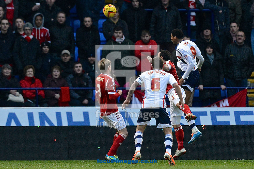 Picture by Ian Wadkins/Focus Images Ltd +44 7877 568959<br /> 11/01/2014<br /> David N'Gog of Bolton Wanderers heads at goal during the Sky Bet Championship match at the Reebok Stadium, Bolton.