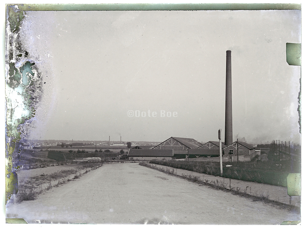 eroding glass plate of river landscape with factory near Paris 1900s