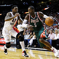 22 January 2012: Milwaukee Bucks shooting guard Stephen Jackson (5) drives past Miami Heat power forward Udonis Haslem (40) during the Milwaukee Bucks 91-82 victory over the Miami Heat at the AmericanAirlines Arena, Miami, Florida, USA.