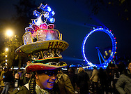 People are celebratingthe New Year in Westminster, near London Eye, in London.