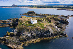 Aerial view of Fidra Island and lighthouse on Firth of Forth in  East Lothian, Scotland, UK